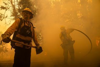 "Firefighters battle the Kincade Fire in Healdsburg, California, on Oct. 27, 2019. Powerful winds spread fires in northern California with ""potentially historic fire"" conditions expected. Credit: Philip Pacheco/AFP/Getty Images"