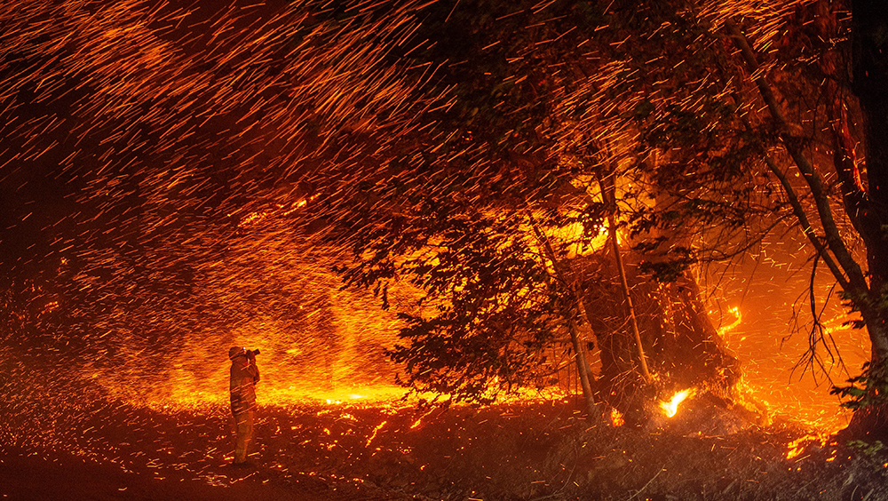 Powerful winds scatter embers from the Kincade Fire. Credit: Josh Edelson/AFP/Getty Images
