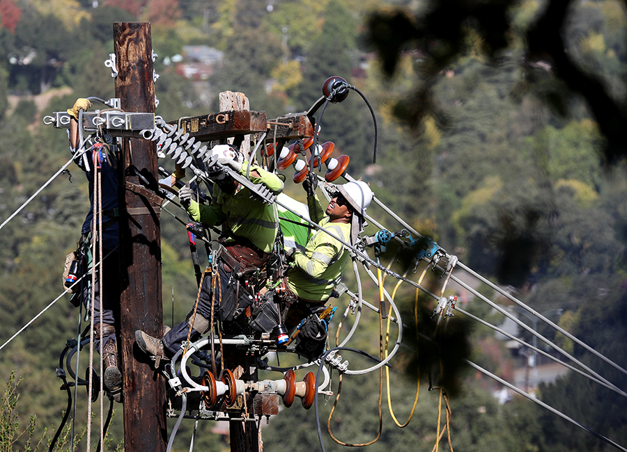 PG&E workers replace a power pole on a hillside in Walnut Creek, Calif., Oct. 23, 2019, that had been the source of several small fires. Credit: Jane Tyska/MediaNews Group/The Mercury News via Getty Images