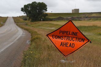Pipeline construction sign. Credit: Robyn Beck/AFP/Getty Images