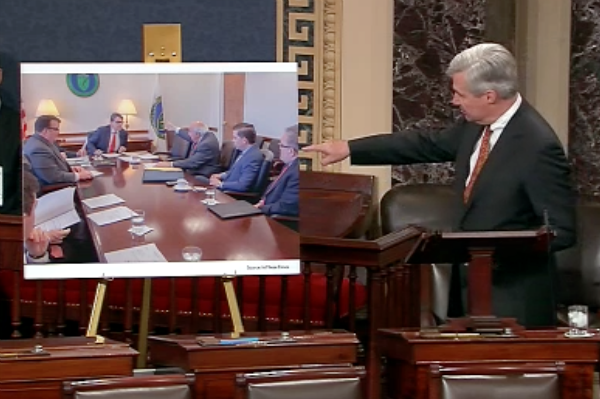 Sen. Sheldon Whitehouse (D-R.I.), points to Andrew Wheeler in a photo of coal company owner Bob Murray meeting with Energy Secretary Rick Perry. Credit: U.S. Senate