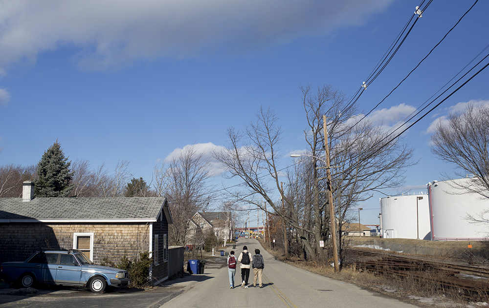 Students walk home from school in a South Portland neighborhood that has become nearly surrounded by petroleum storage tanks. Credit: Brianna Soukup/Portland Press Herald via Getty Images