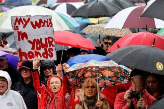 Climate protest sign: My world is in your hands. Credit: Lisa Maree Williams/Getty Images