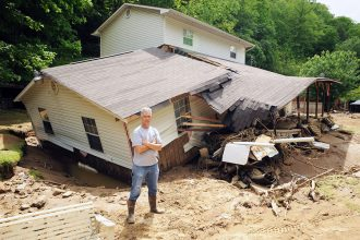 Floodwater that swept down Pigeon Creek hit Eddie Fields' home in Pie, West Virginia, and many of his neighbors' homes in May 2009. New research shows the flood risk in strip-mined regions like his is rising. Credit: Logan Banner file photo