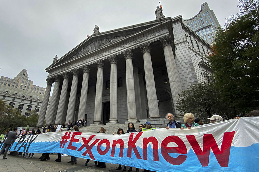 Protesters outside court on the opening day of the Exxon trial in 2019. Credit: Eduardo MunozAlvarez/VIEWpress via Getty Images