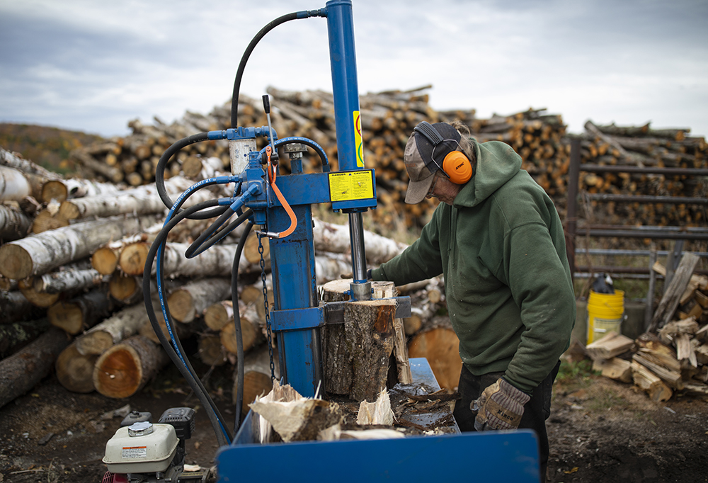 Splitting wood for fires and wood-burning stoves. Credit: Robert Nickelsberg/Getty Images