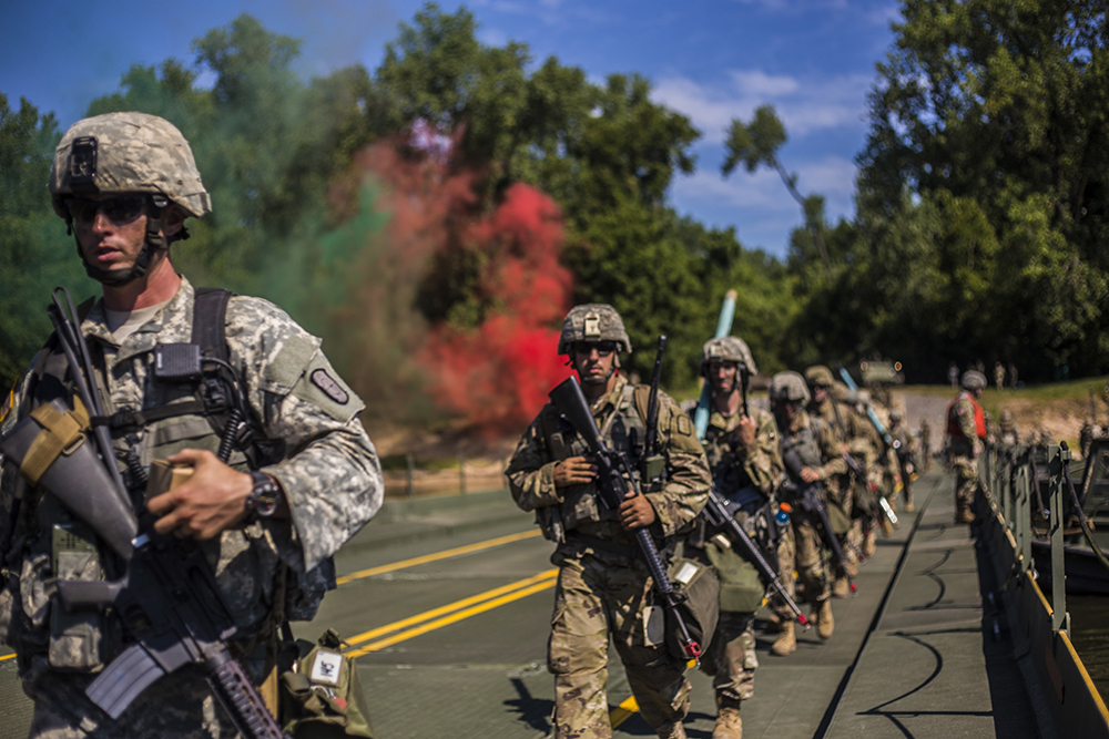 Marines with an 926th Engineer Brigade are loaded with gear to practice bridge construction at Fort Chafee, Arkansas, in late July 2018. Credit: Lance Cpl. Quentarius Johnson/U.S. Marine Corps