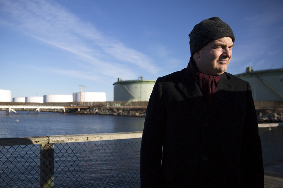 Mayor Claude Morgan stands near some of South Portland's petroleum tanks. Credit: Brianna Soukup/Portland Press Herald via Getty Images