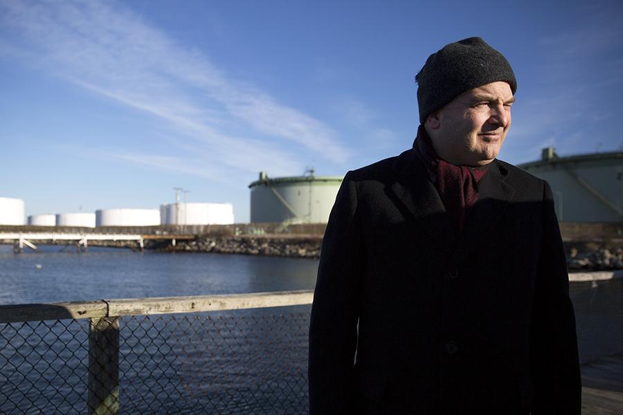 Mayor Claude Morgan stands near some of South Portland's petroleum tanks. Credit: Brianna Soukup/Portland Press Herald via Getty Images
