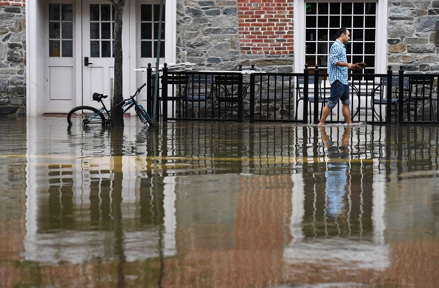 As sea level rises, coastal flooding during storms and high tides is becoming a growing problem in parts of Virginia, including in Alexandria's historic Old Town and around Naval Station Norfolk. Credit:  Matt McClain/The Washington Post via Getty Images