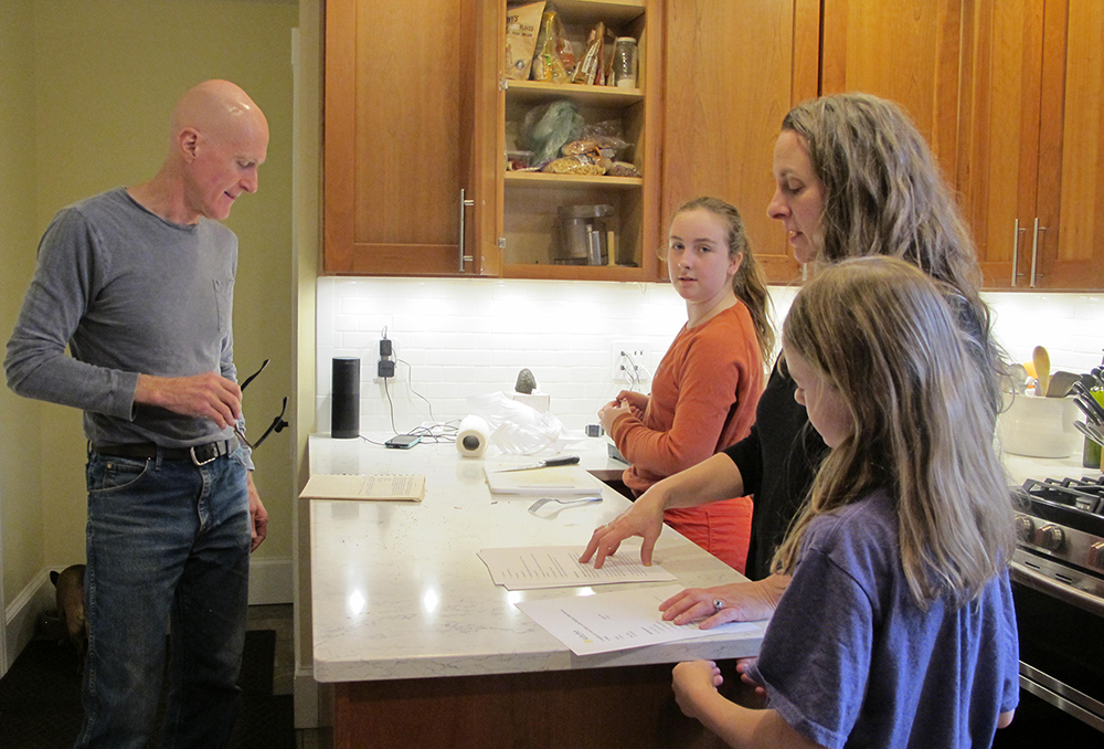 Dave and Julie Falatko with their daughters, Zuzu and Ramona. Zuzu, 11, (second from left) was diagnosed with asthma, and Dave and Julie worry their proximity to the oil tanks may be to blame. Credit: Sabrina Shankman