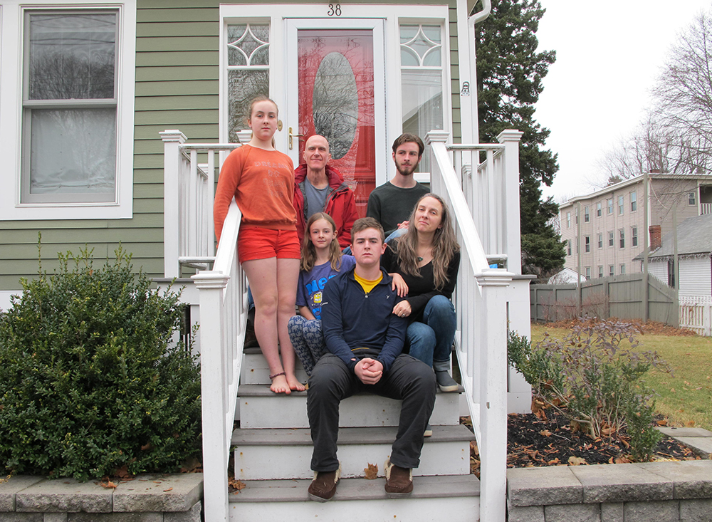 Julie and Dave Falatko, pictured here with their children, spent 14 years renovating their home, which sits less than a quarter mile from two different tank farms. Credit: Sabrina Shankman