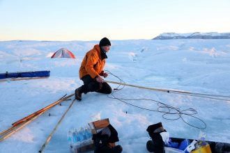 Scientists on Greenland's Petermann Glacier. Credit: Whitney Shefte/Washington Post via Getty Images