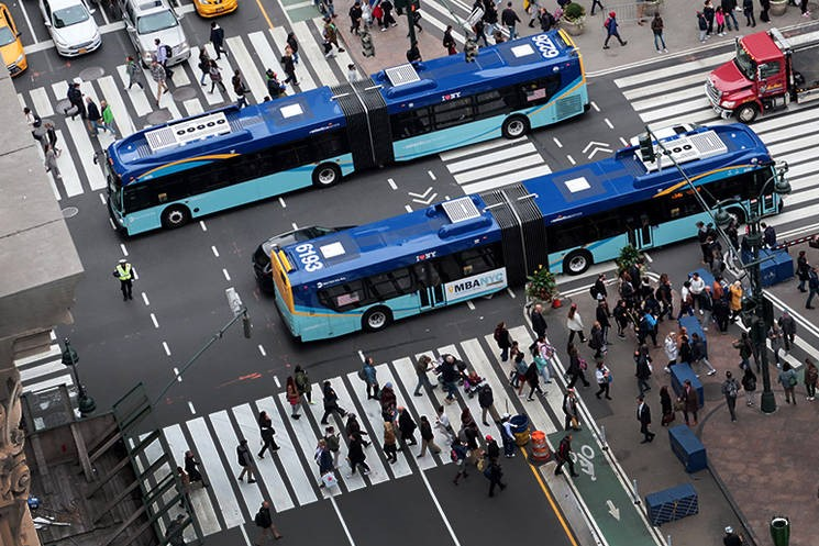 Walkers, buses and bike lanes. Credit: Gary Hershorn/Getty Images