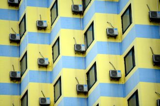 Air conditioning units hang off the back side of a row of buildings on July 18, 2018 in Shenyang, Liaoning Province of China. Credit: Visual China Group via Getty Images