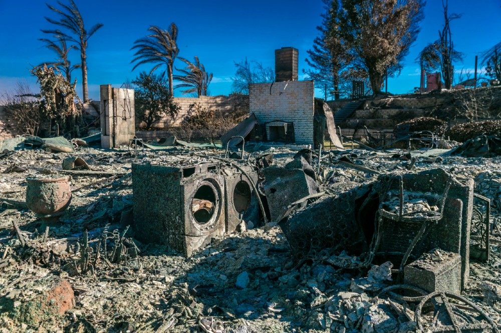Remains of a washer/drier in a home demolished by a Ventura, California, wildfire. Credit: Visions of America/Universal Images Group/Getty Images