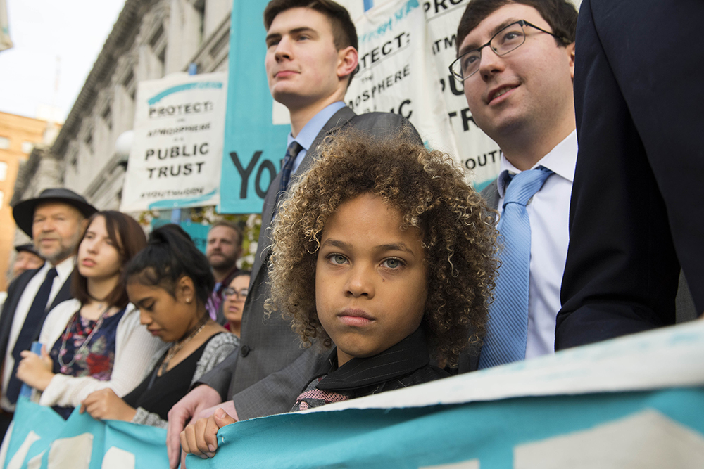 Young plaintiffs stand outside a courthouse in 2017. Credit: Robin Loznak