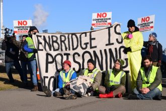 """Activists are fighting against the construction of a natural gas compressor and pipeline that one activist called """"a carbon bomb."""" Credit: Phil McKenna/InsideClimate News"""
