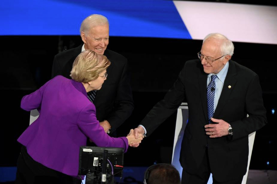 Sen. Bernie Sanders (I-Vt.) and Sen. Elizabeth Warren (D-Mass.) shake hands at the Democratic primary debate on Jan. 14, 2020. Credit: Robyn Beck/AFP/Getty Images