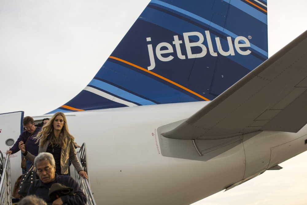 Passengers leaving JetBlue aircraft Credit: Robert Nickelsberg/Getty Images