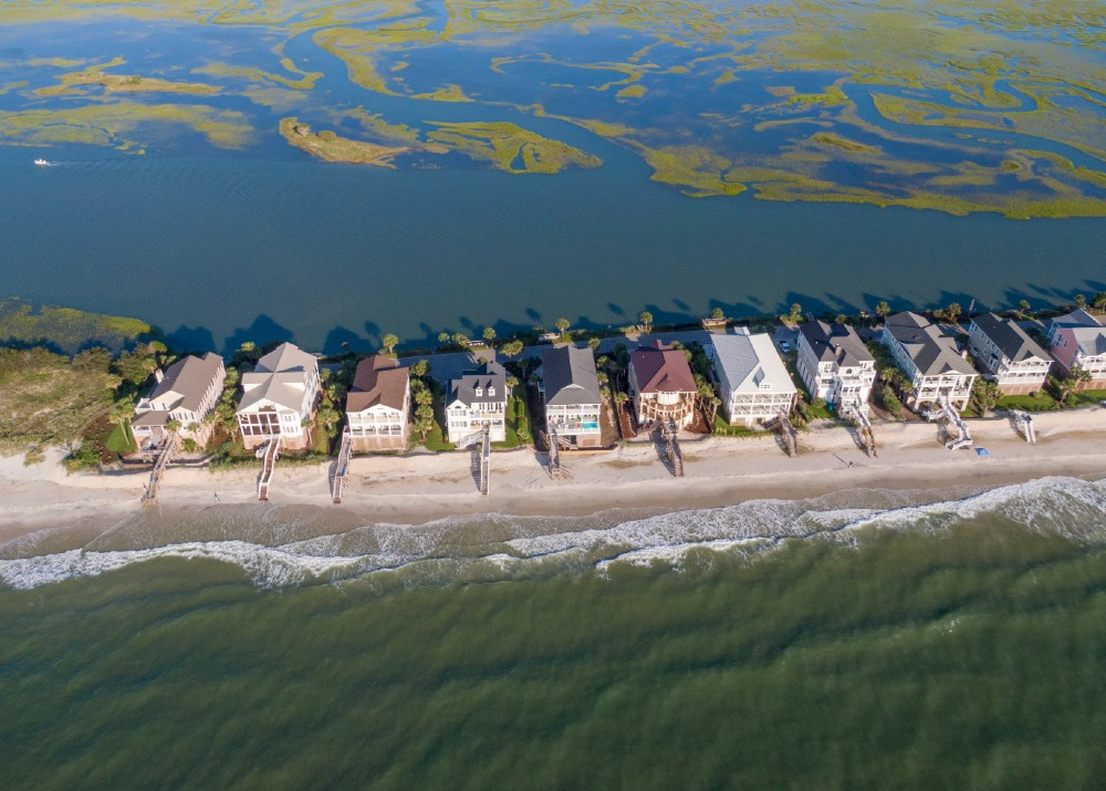 Homes along a sand spit of land on Litchfield Beach, South Carolina. Credit: Jason Lee, McClatchy newspapers