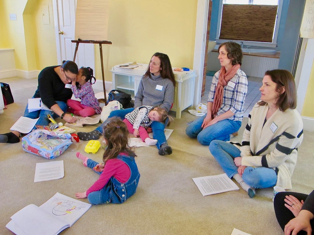 A group of concerned parents and their young kids listen as Protect South Portland organizers talk about how to engage in the activists' fight for clean air. Credit: Sabrina Shankman/InsideClimate News
