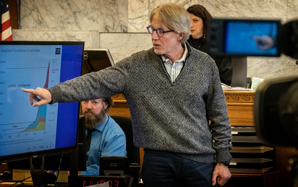 Deke Gunderson testifies on the science of climate change and its impact. Credit: Rick Rappaport