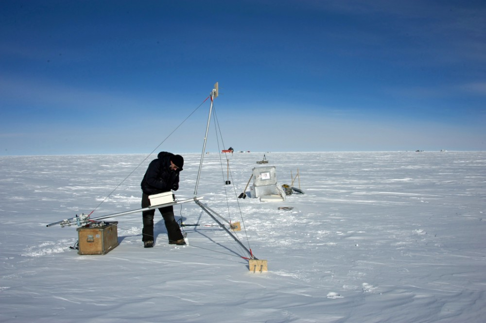 A researcher assembles an automatic weather station. Credit: East Greenland Ice-core Project