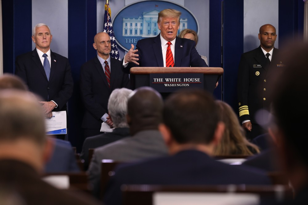 President Donald Trump talks to reporters with members of the White House Coronavirus Task Force. Credit: Chip Somodevilla/Getty Images