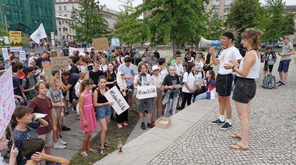 Pauline Daemgen (right foreground) and Quang Anh Paasch (left) lead the crowd at a Fridays for Future demonstration Sept. 27, 2019 in Berlin. Credit: Dan Gearino/InsideClimate News
