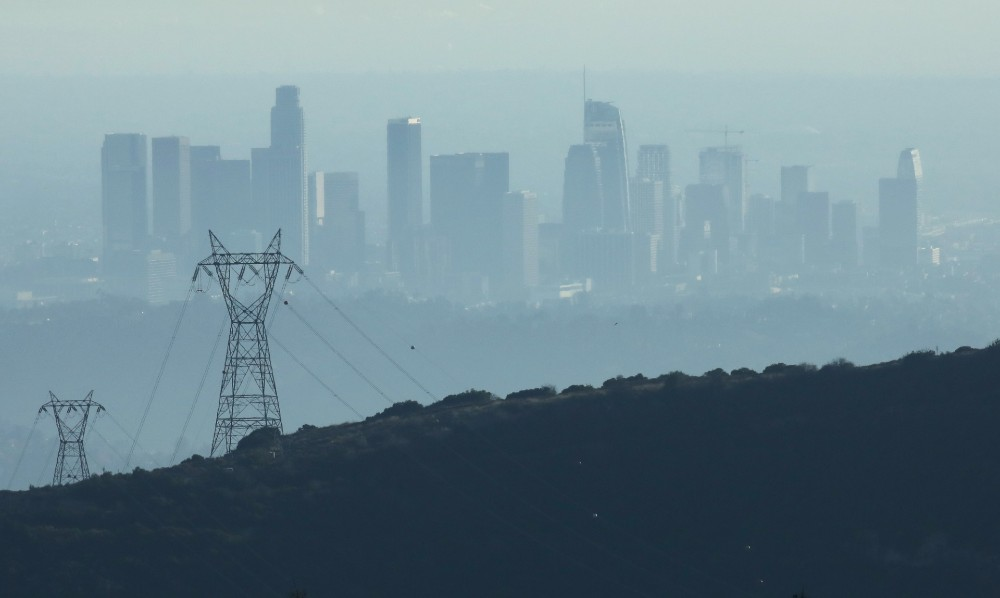 The buildings of downtown Los Angeles are partially obscured in the late afternoon on November 5, 2019 as seen from Pasadena, California.