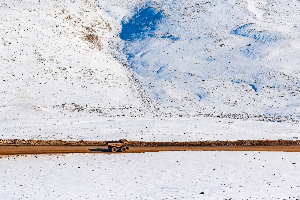 A truck carries ore excavated from the Mary River iron mine across the frozen landscape of Canada's Baffin Island. Baffinland Iron Mines Corporation wants to more than quadruple the mine's production, starting in 2025. Credit: Baffinland Media Centre