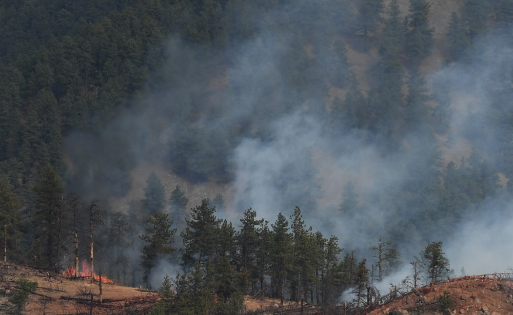 Fire crews work a wildfire in Sunshine Canyon on March 19, 2017 in Boulder, Colorado. Credit: RJ Sangosti/The Denver Post via Getty Images