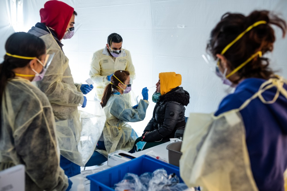 Doctors test hospital staff with flu-like symptoms for Covid-19 in set-up tents before they enter the main emergency department area at St. Barnabas Hospital in the Bronx on March 24. Credit: Misha Friedman/Getty Images