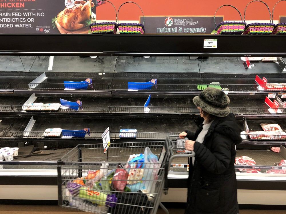 Meat shelves lay empty at a supermarket in Saugus, Massachusetts on March 13, 2020. Credit: Joseph Prezioso/AFP via Getty Images