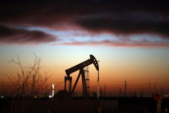 An oil pumpjack works at dawn in the Permian Basin oil field on January 20, 2016 in the oil town of Andrews, Texas. Credit: Spencer Platt/Getty Images