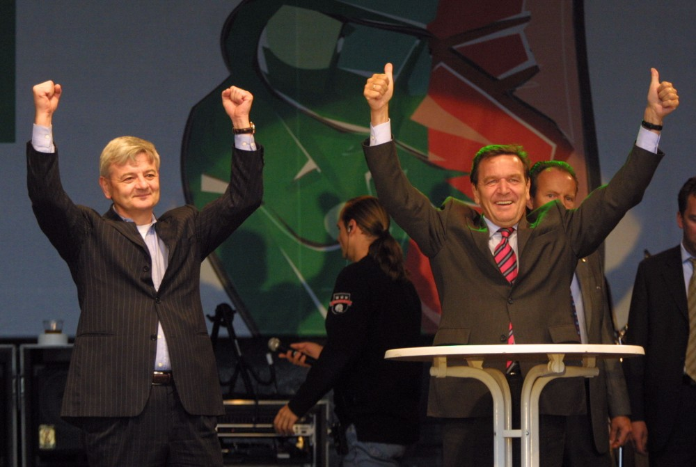 German Chancellor and Social Democrat Gerhard Schröeder (right) and German Foreign Minister and Alliance90/The Greens leader Joschka Fischer gesture at an election campaign rally in 2002. Credit: Sean Gallup/Getty Images