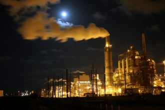 A full moon rises over the Valero Refinery. Credit: David Woo/Corbis via Getty Images