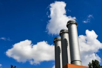 Inactive smoke stacks. Credit: Jens Kalaene/picture alliance via Getty Images