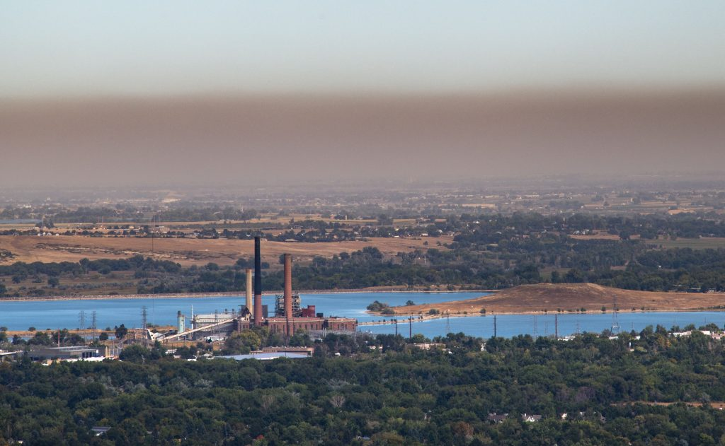 """Boulder, Colorado's Valmont Generating Station sits underneath the """"brown cloud"""" of pollution that has plagued the air of the Front Range of Colorado. Credit: Ted Wood"""