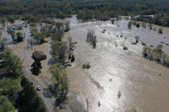 The Tittabawassee River breached a dam on May 20, 2020 in Sanford, Michigan, requiring thousands of residents to evacuate. Credit: Gregory Shamus/Getty Images