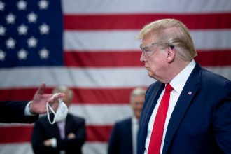 President Donald Trump tours a Honeywell International Inc. factory producing N95 masks in Phoenix, Arizona. Credit: Brendan Smialowski/AFP via Getty Images