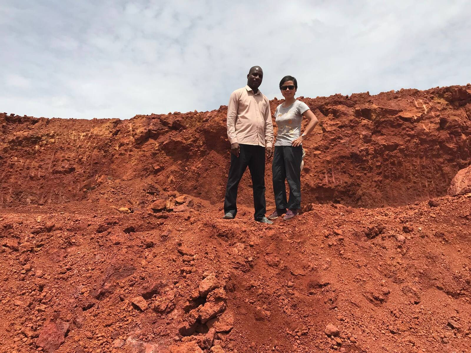 In Guinea, Zhang Jingjing works with Mamady Koivogui and other local environmentalists to decrease the pollution and social disruption caused by Chinese bauxite mining. Courtesy of Zhang Jingjing