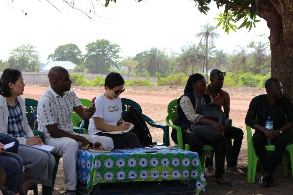 Zhang Jingjing meets with community members in Boke, Guinea in June 2019. Courtesy Zhang Jingjing