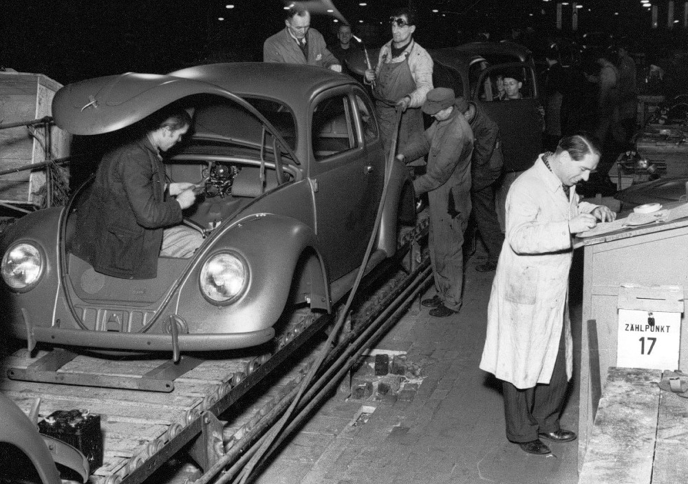 A Volkswagen Beetle rolls off of the assembly line in the 1940s at the company's flagship plant in Wolfsburg, Germany. Credit: Volkswagen