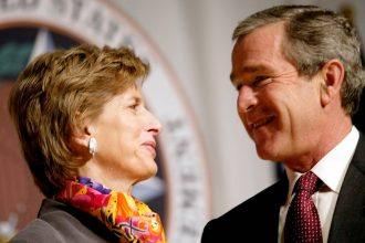 President George W. Bush talks with Environmental Protection Agency Administrator Christie Whitman in 2002. Credit: Stephen Jaffe/AFP via Getty Images