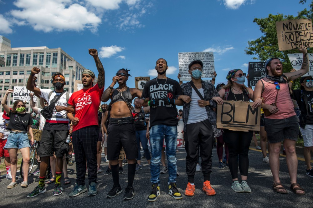 Demonstrators march near the White House in Washington, D.C. while protesting against police brutality and racism. Credit: Probal Rashid/LightRocket via Getty Images