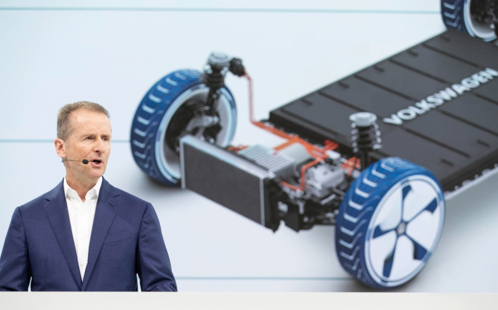 Volkswagen CEO Herbert Diess speaks at a news conference in March 2019, announcing a major increase in electric vehicle production. Credit: Volkswagen