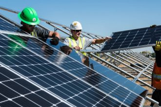 Workers install PV modules in September 2016. Credit: Dennis Schroeder/NREL