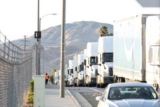Trucks drive by San Bernardino, California. Courtesy of Anthony Victoria/Center for Community Action and Environmental Justice